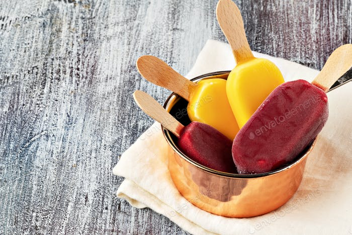 Fruit popsicles ice cream on a plate.