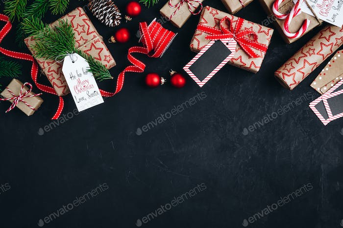 Christmas background with fir branches and cones gift boxes with red bow ribbon