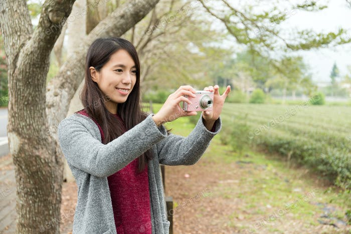 Woman take a picture by using camera