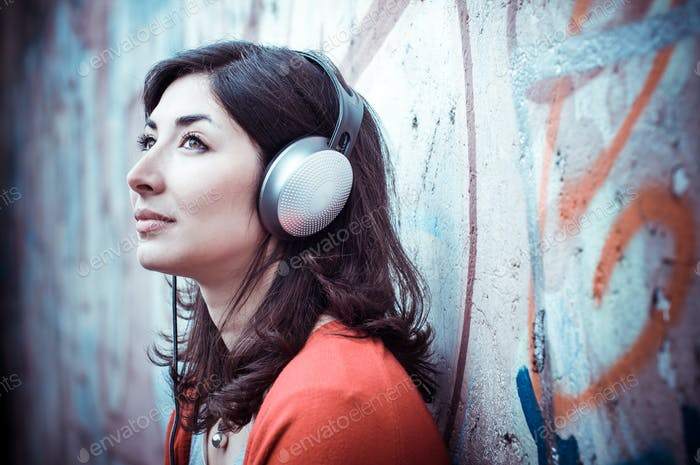 Beautiful stylish woman listening to music