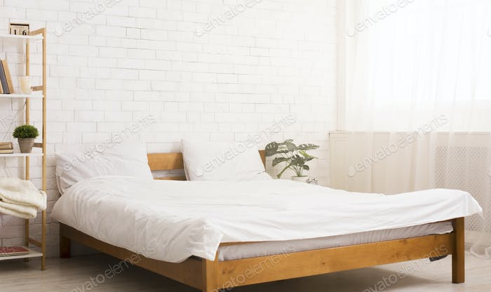 Comfortable bedroom interior with bed, empty space