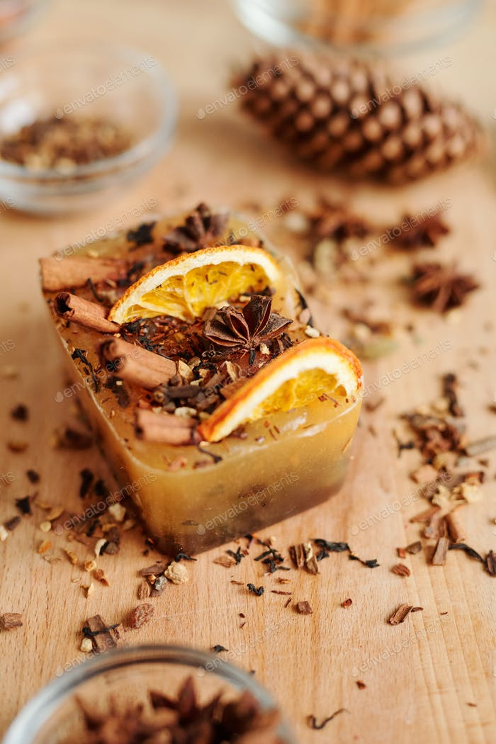 Large handmade soap bar with cinnamon sticks, star anise and orange slices