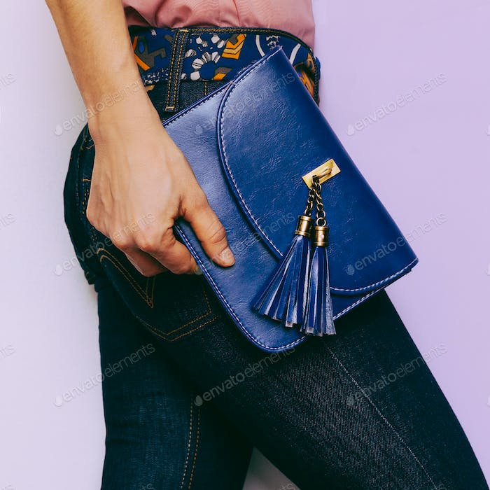 Lady in blue jeans and fashion accessories. Bag Country Style