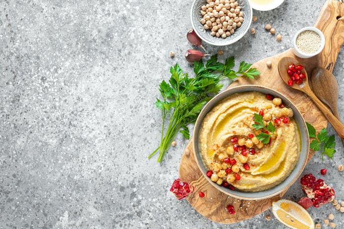 Chickpea hummus with tahini in a bowl. Healthy vegetarian appetizer. Middle Eastern cuisine