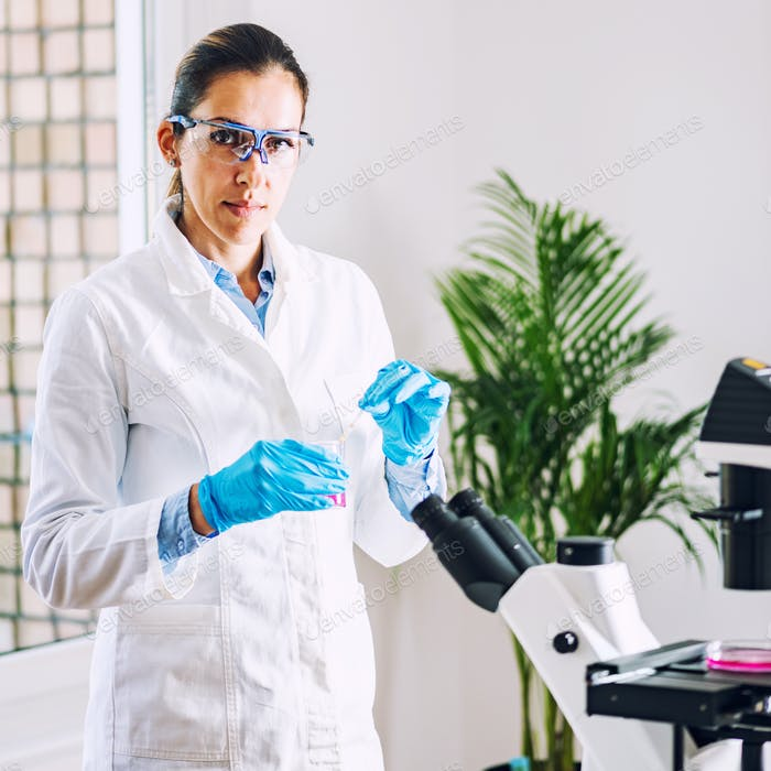 Lab technician with urine sample in laboratory