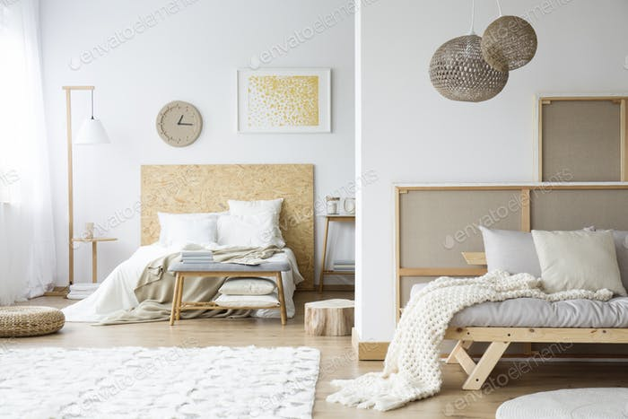 Natural bedroom with wooden bedhead