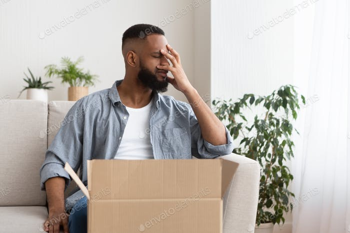 Disappointment in online shopping concept. Guy presses hand to face