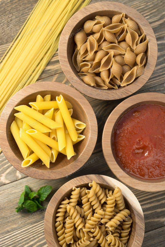 Variety of Pasta Wooden Bowls Cutting Boards Marinara Sauce