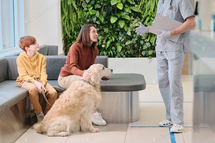 People with pet at clinic