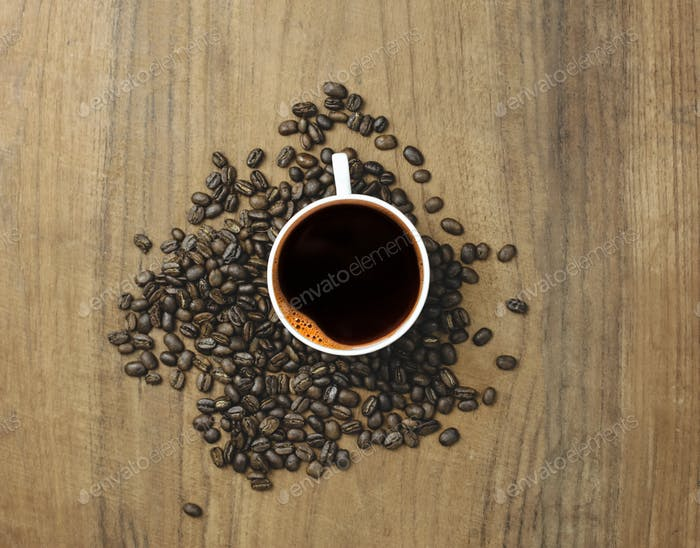 top view black coffee and coffee beans with wood background