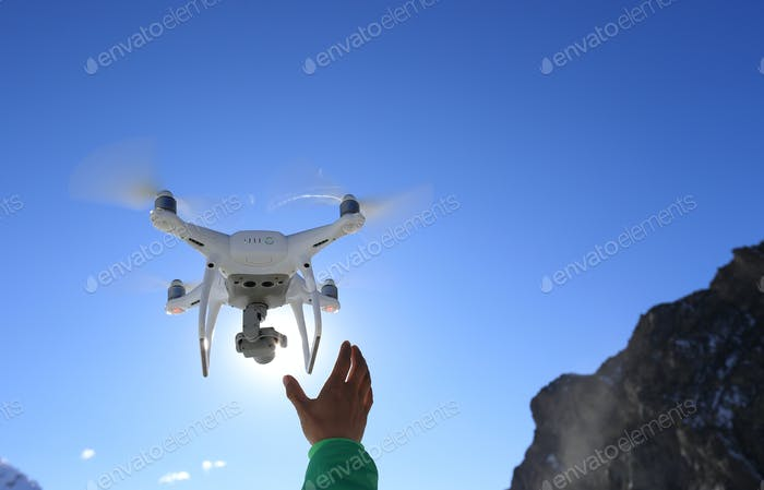 Drone flying in high altitude sky