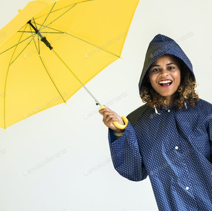 Happy girl with yellow umbrella