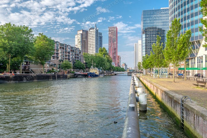 Rotterdam city cityscape skyline with water canal in front, South Holland, Netherlands.