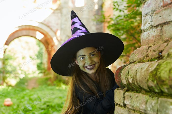 Smiling Little Witch in Castle