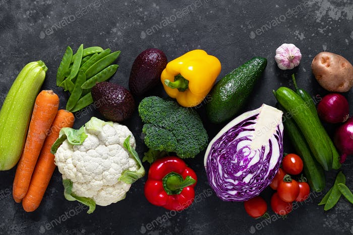 Healthy food, fresh raw green organic fruits and leafy vegetables