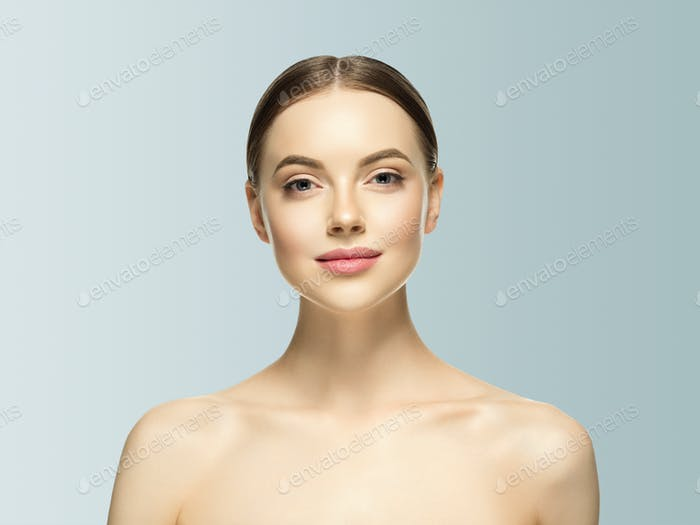 Woman face beauty healthy skin natural makeup beautiful female gray background
