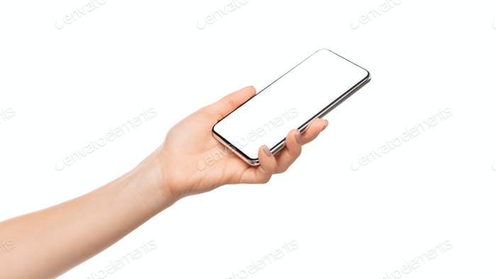 Woman's hand presenting modern smartphone with blank screen