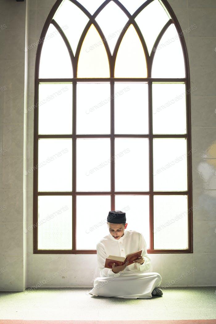 Muslim man studying The Quran
