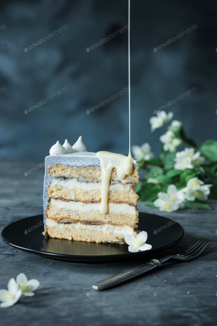 Slice of Birthday Cake with a flowers over a blue background.