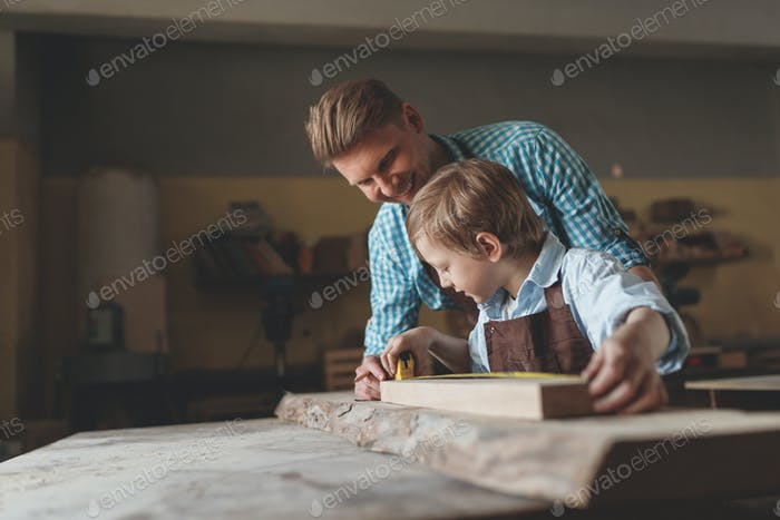 Father and son at work