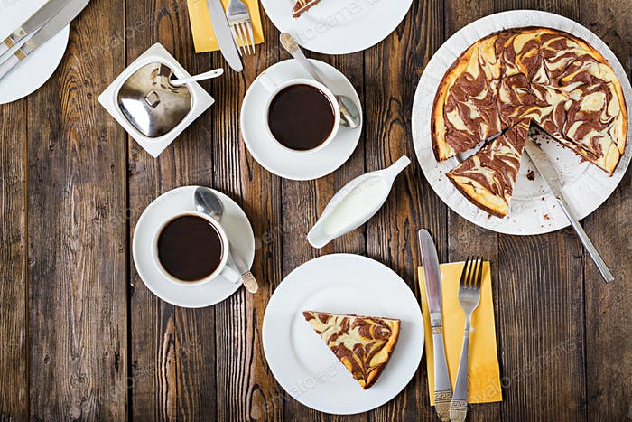Chocolate cheesecake and coffee on wooden background. Cup coffee and cheesecake.Top view. Flat lay