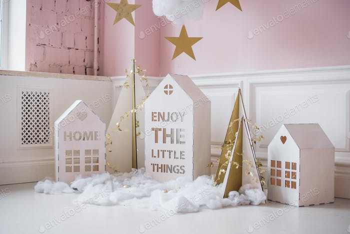 Small christmas houses decoration and stars hanging