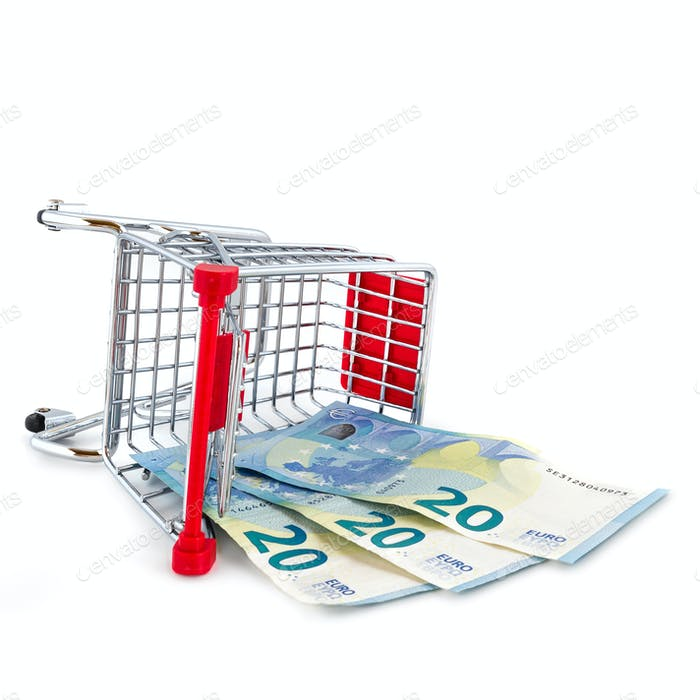 Scattered shopping cart with money