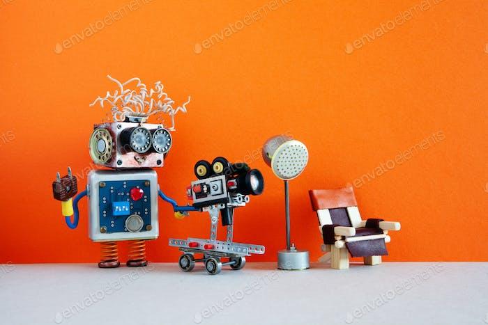 Funny robotic filmmaker operator with retro camera