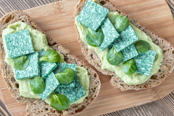 Slices of toasted bread with avocado paste