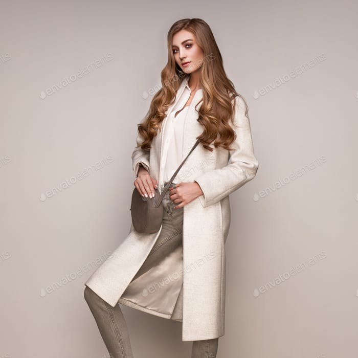 Young woman in white autumn coat