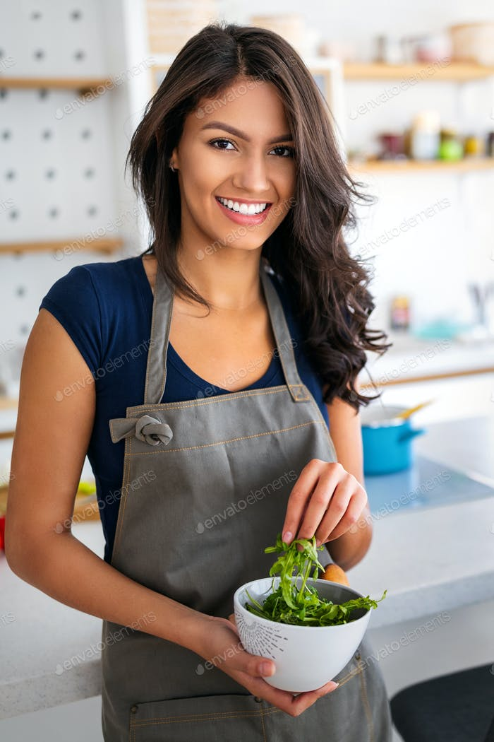 Beautiful healthy woman eating salad. Dieting, healthy lifestyle concept