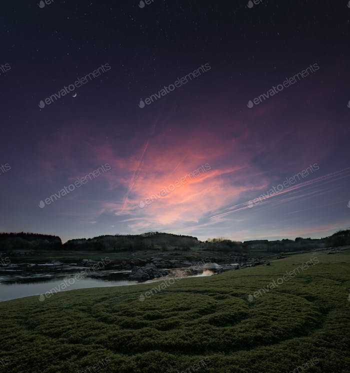 Twilight sky with golden clouds and first stars