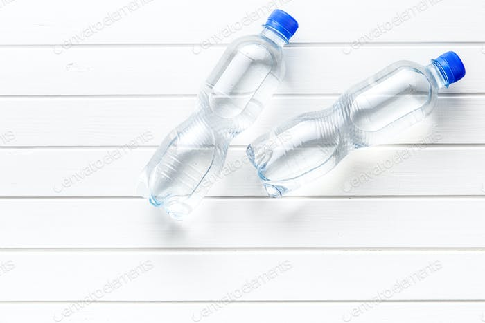 Small plastic water bottle.