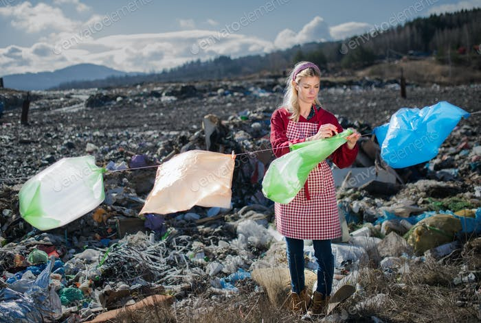 Woman on landfill, consumerism versus plastic pollution concept