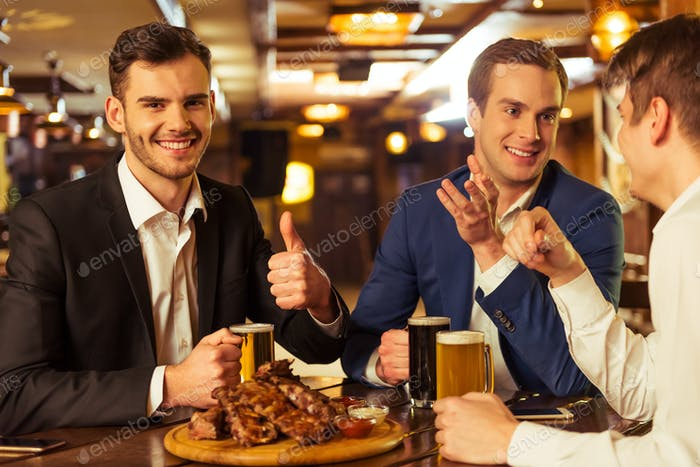 Businessmen in pub