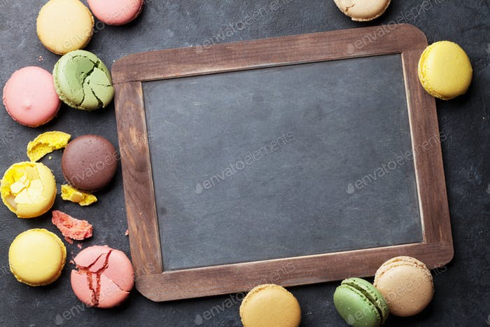 Colorful macaroons and blackboard