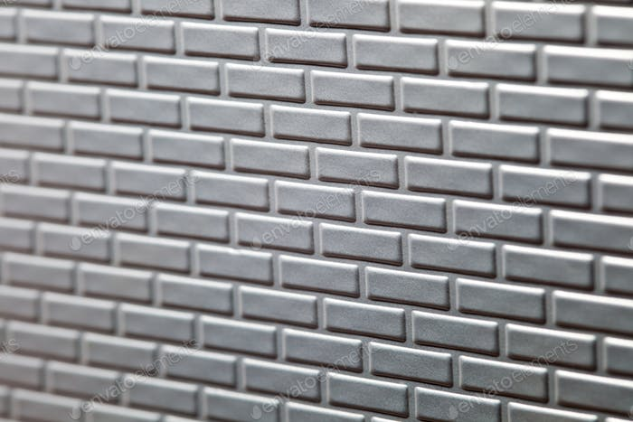 Wall of metallic bricks