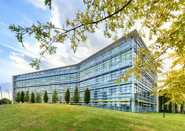 Modern glass fronted office building in spring