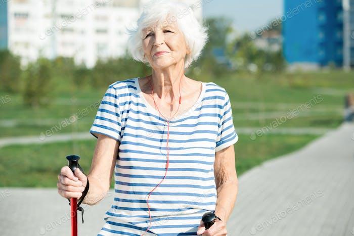 Modern Senor Woman Enjoying Nordic Walking