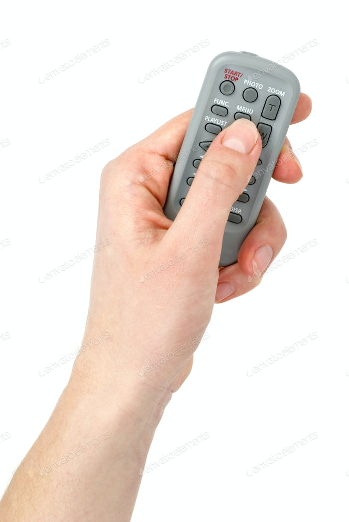 Hand with Tiny infra-red remote control unit
