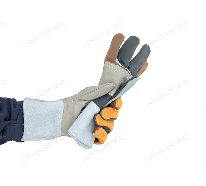 Hand in rough leather glove on white