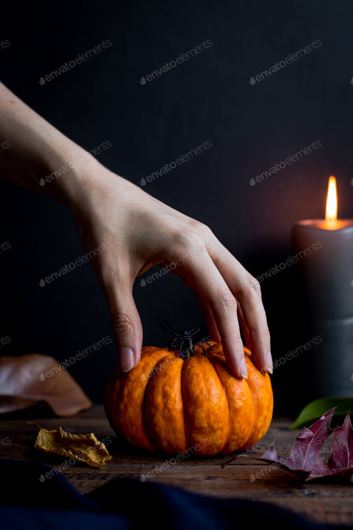 Spooky Hand and Halloween Pumpkin