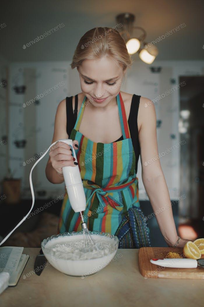 Young girl prepares dessert