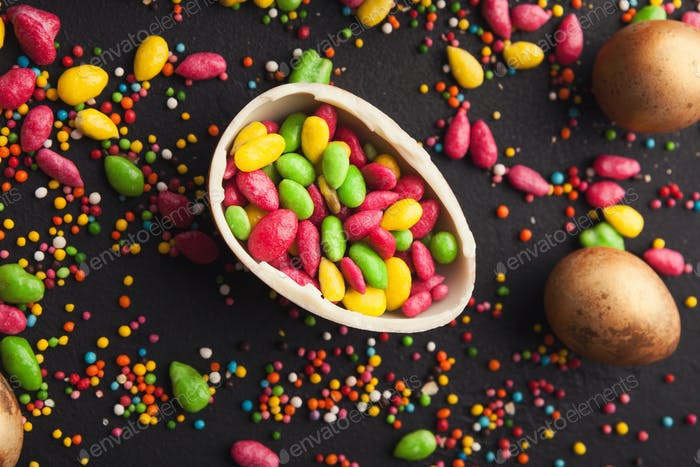 Chocolate egg and colorful candies