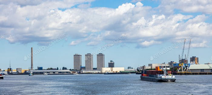 Container ship and logistics against Rotterdam cityscape