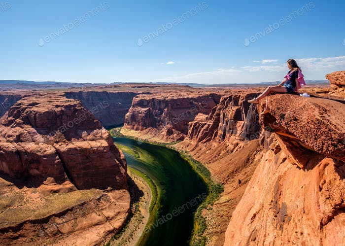 Tourist at Horseshoe Bend on Colorado River
