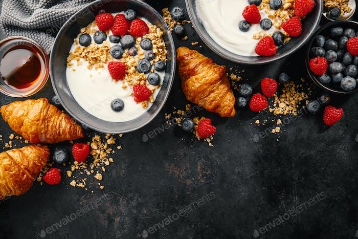 Yogurt with berries and granola in bowl