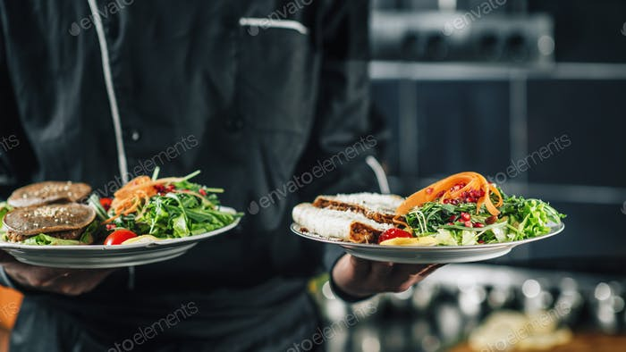 Chef Holding Plate with Organic Vegan Meal
