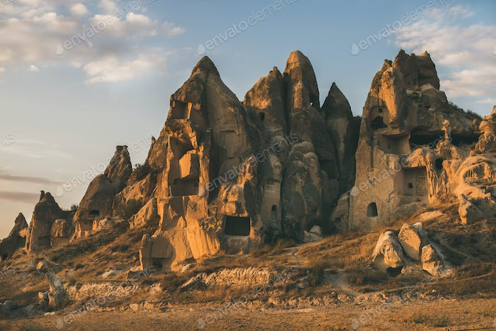 Natural volcanic rocks with ancient cave houses, Cappadocia, Turkey