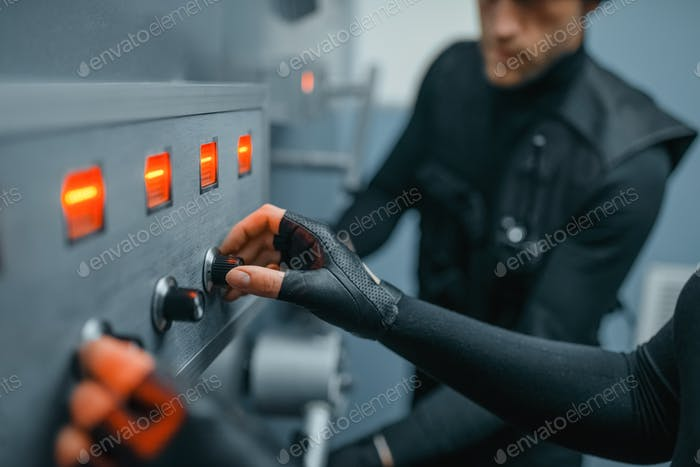Robbers in black uniform trying to find the code